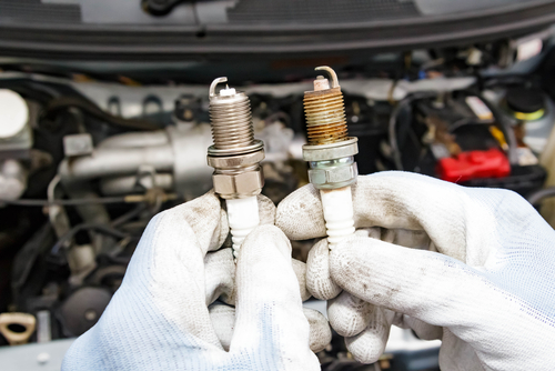 New and old spark plugs